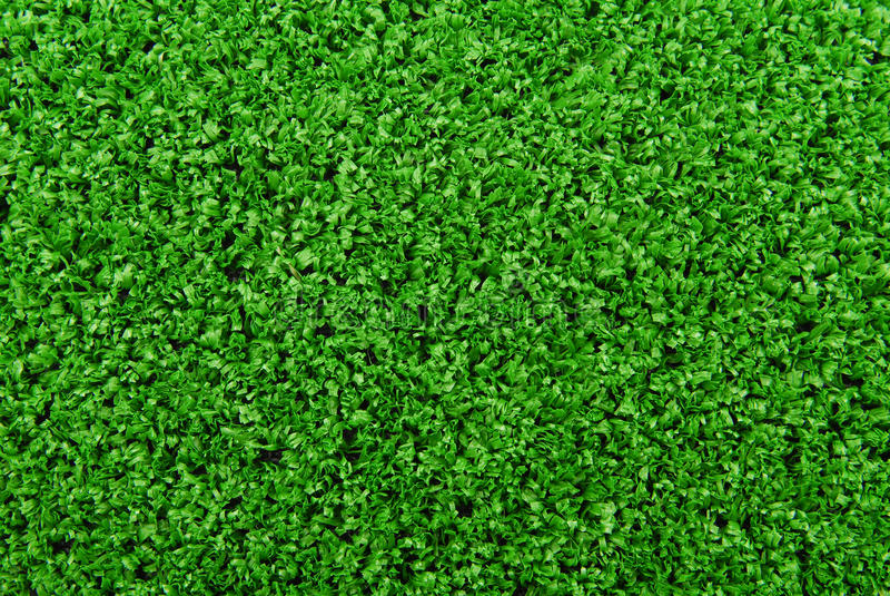 De kunstmatige achtergrond van het grasgras royalty-vrije stock foto
