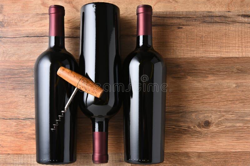 De Kurketrekker van drie Wijnflessen stock foto