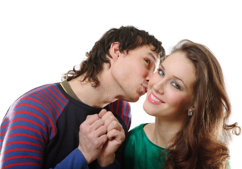 De kussende vrouw van de man stock afbeelding
