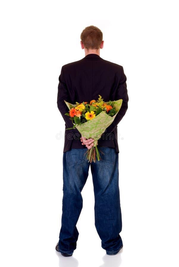 De l'adolescence avec le bouquet des fleurs images libres de droits