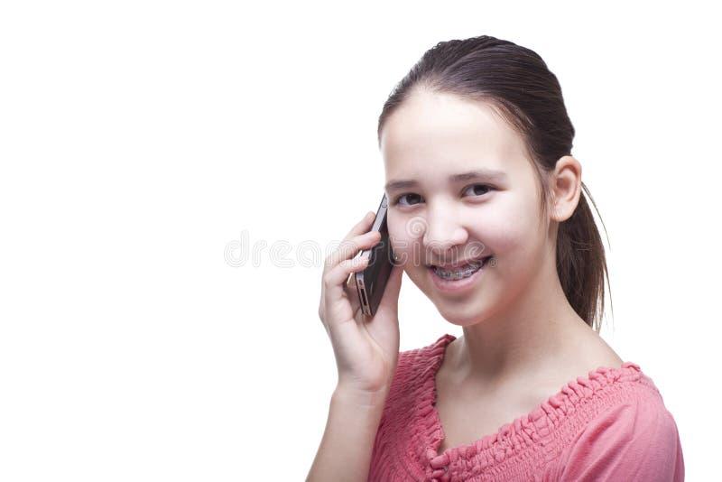 De l'adolescence avec le téléphone portable image stock