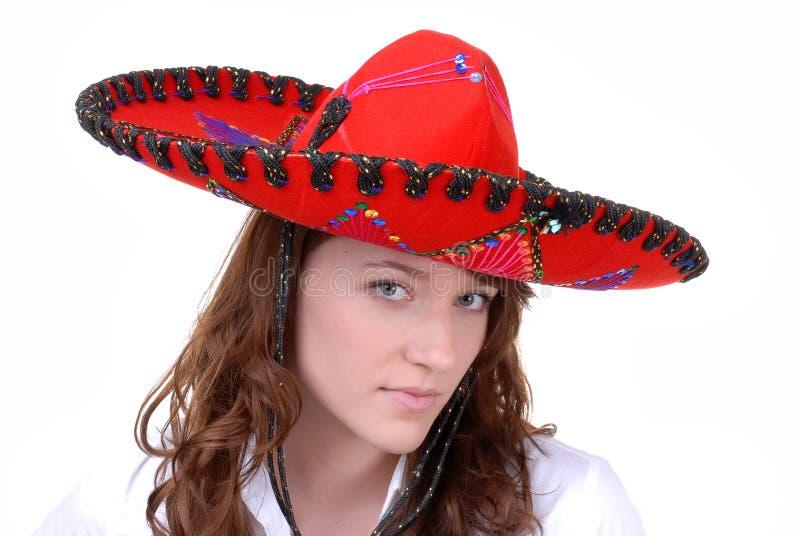 De l'adolescence dans le chapeau mexicain coloré photo libre de droits