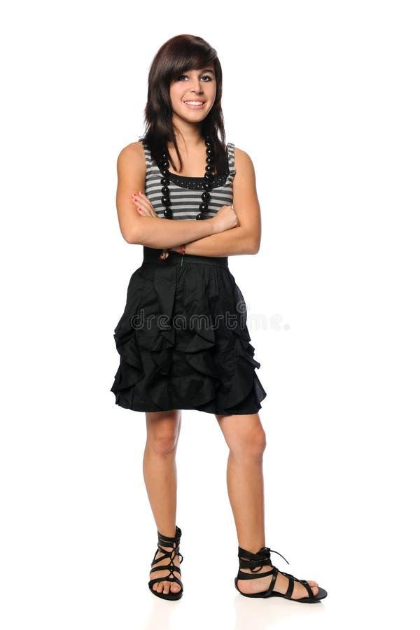 De l'adolescence hispanique avec des bras a croisé images stock
