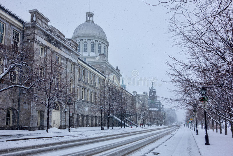De la Commune Street and Bonsecours Market. On a snowy day, Montreal royalty free stock images