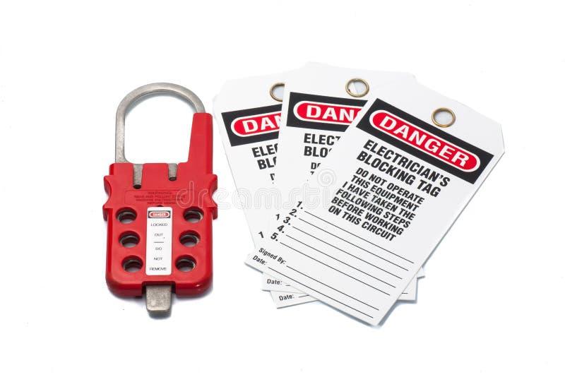 De la etiqueta etiqueta del peligro hacia fuera con el cerrojo fotografía de archivo libre de regalías