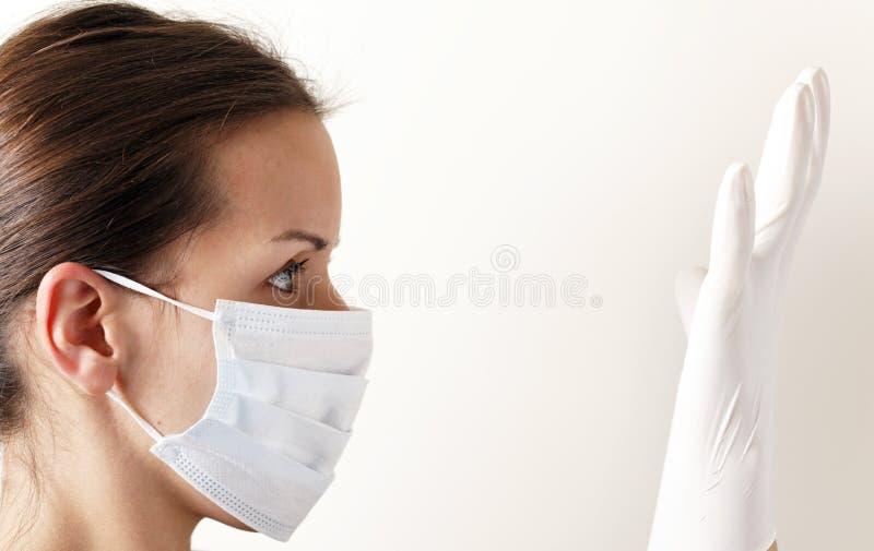 De la máscara del guante gripe otra vez imagen de archivo libre de regalías