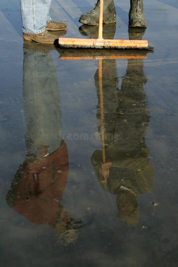 De Laarzen en de Bezinningen van het werk royalty-vrije stock fotografie