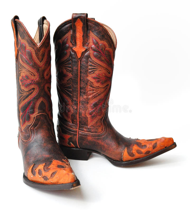 De laarzen van de leercowboy op witte achtergrond stock foto