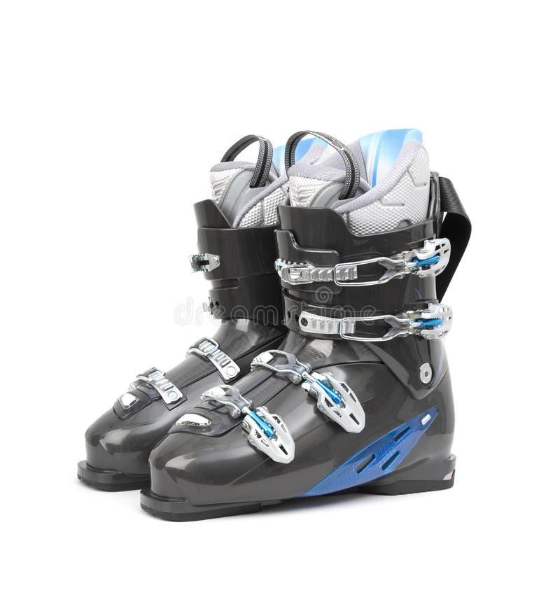 De laarzen van de ski die op wit worden geïsoleerd stock foto