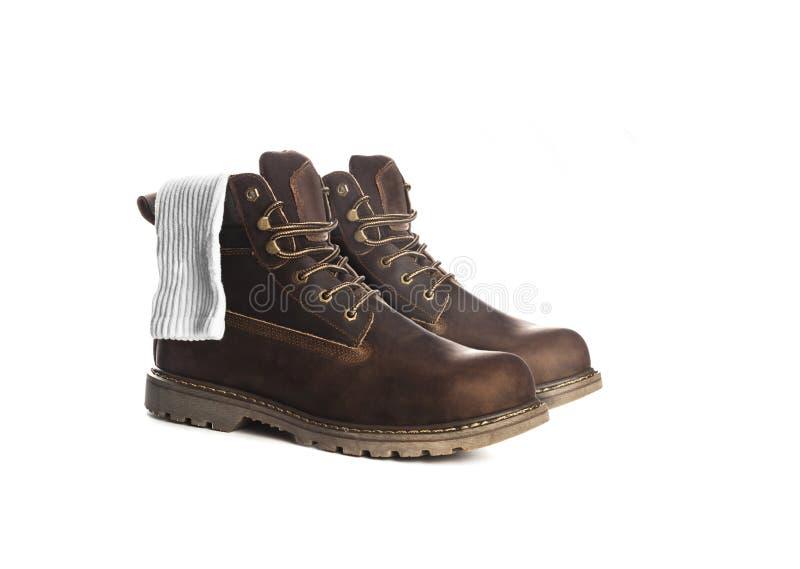 De laarzen van de mensenenkel, bruine kleur, met nubuckleer, met wit zo stock afbeeldingen