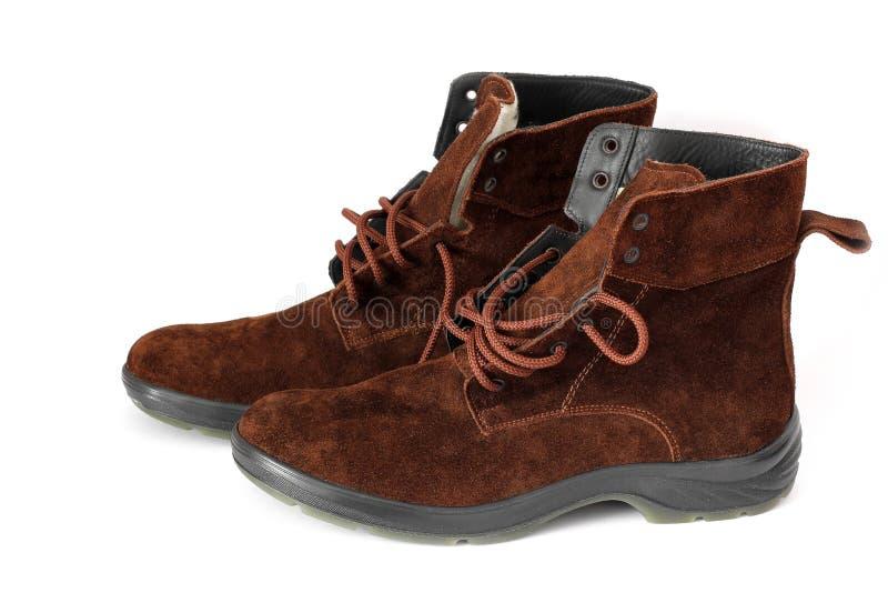 De laarzen van de winter op een witte achtergrond stock afbeelding