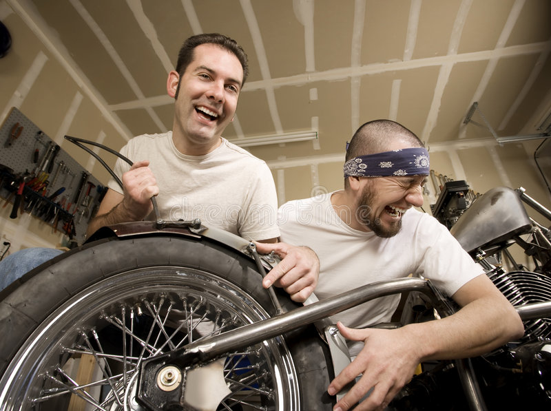 De lachende Werktuigkundigen van de Motorfiets royalty-vrije stock foto