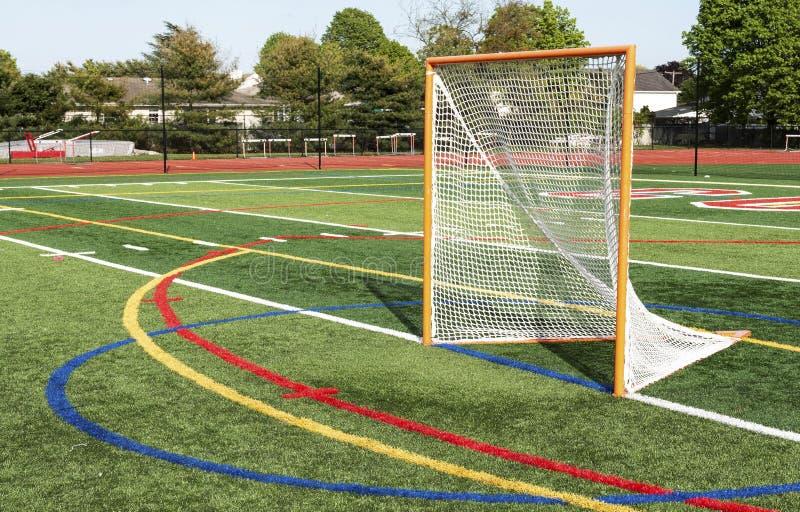 But de lacrosse sur un champ de gazon photos stock