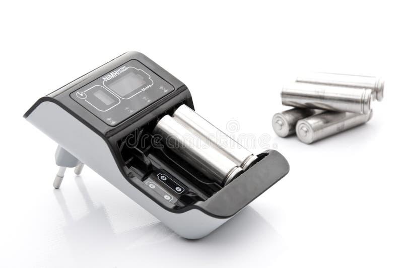 De Lader van de batterij met Batterijen royalty-vrije stock foto's