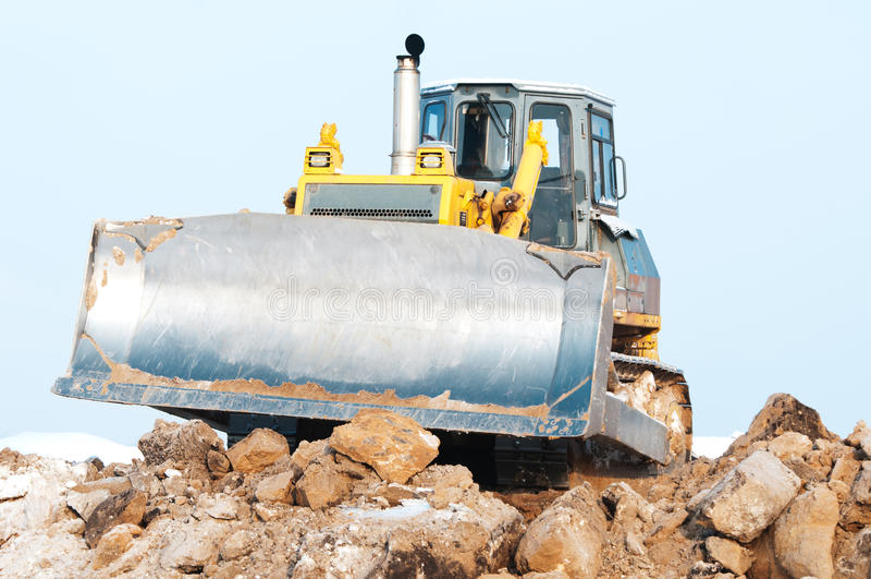 De lader van de bulldozer bij bevroren de winter stock foto's
