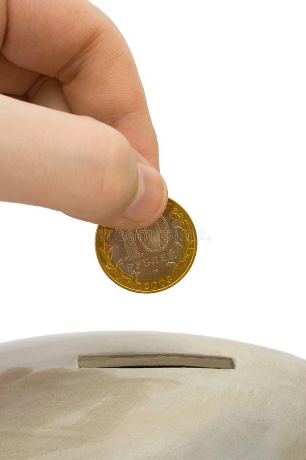 De ladingsmuntstuk van de hand aan bank royalty-vrije stock foto