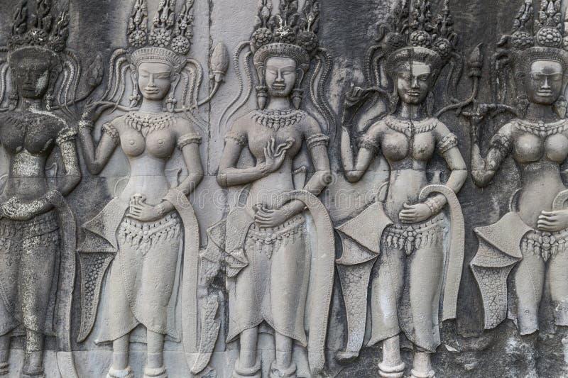 De lage hulp van Apspadansers op de muur in Angkor Wat, Kambodja stock foto's