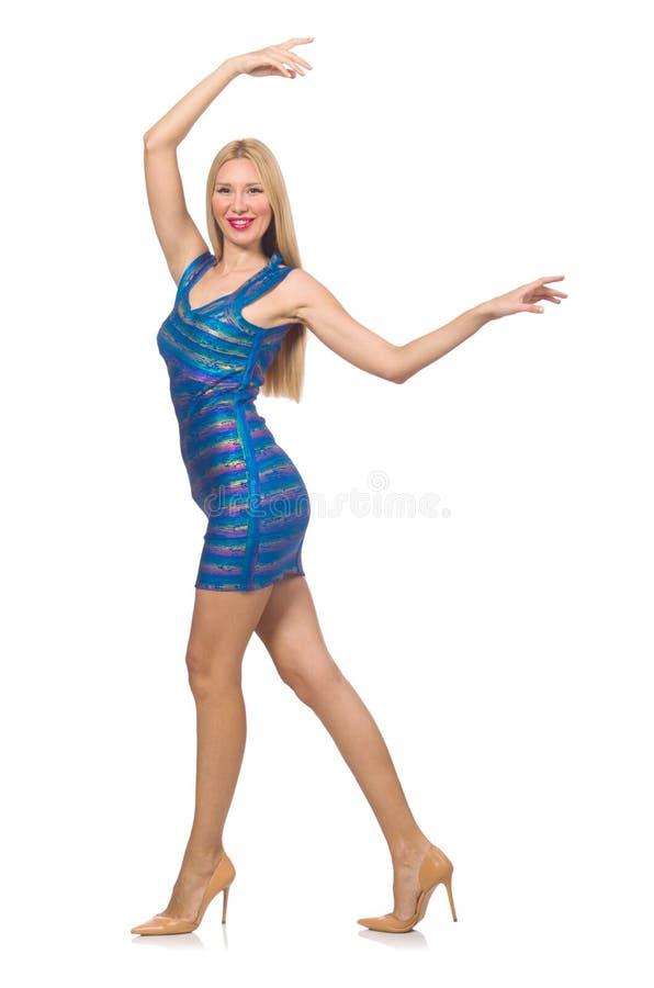 De lange blonde vrouw in mini blauwe die kleding op wit wordt geïsoleerd royalty-vrije stock foto's