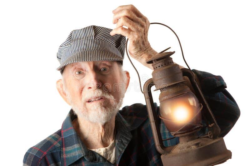 De lantaarn van de de mensenholding van de spoorweg royalty-vrije stock afbeeldingen