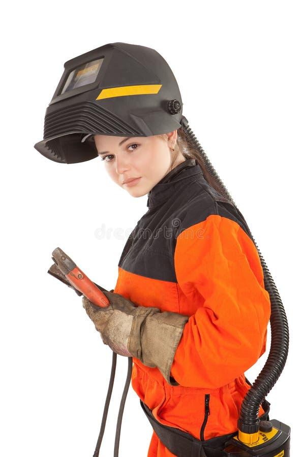 De lassersarbeider van het meisje in lassenmasker stock afbeelding