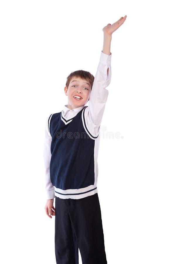 De leerling heft omhoog zijn hand op royalty-vrije stock afbeelding