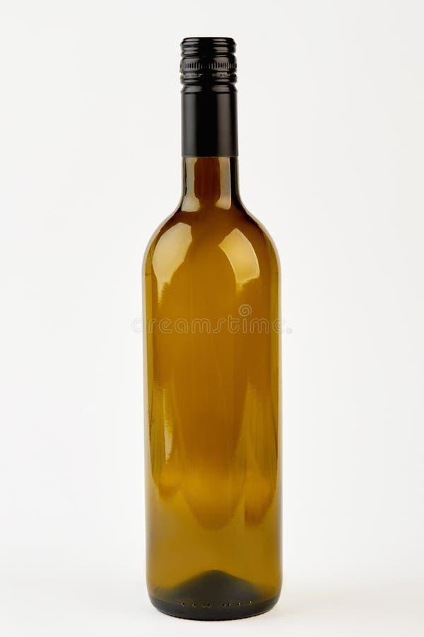 De lege donkere fles van de glaswijn stock foto's