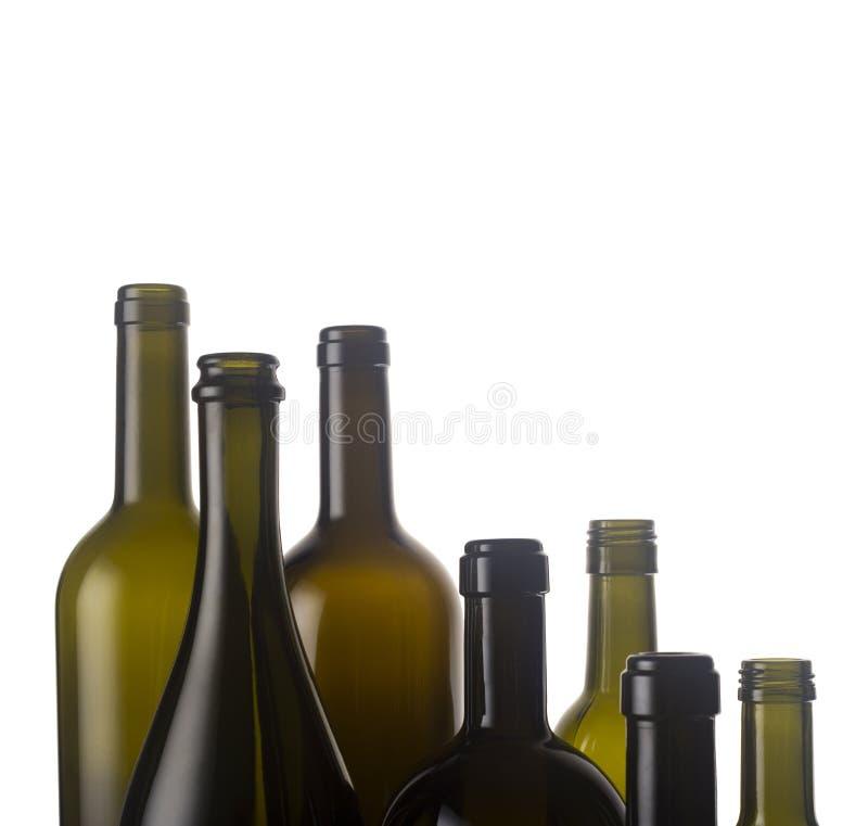 De lege Flessen van de Wijn stock fotografie
