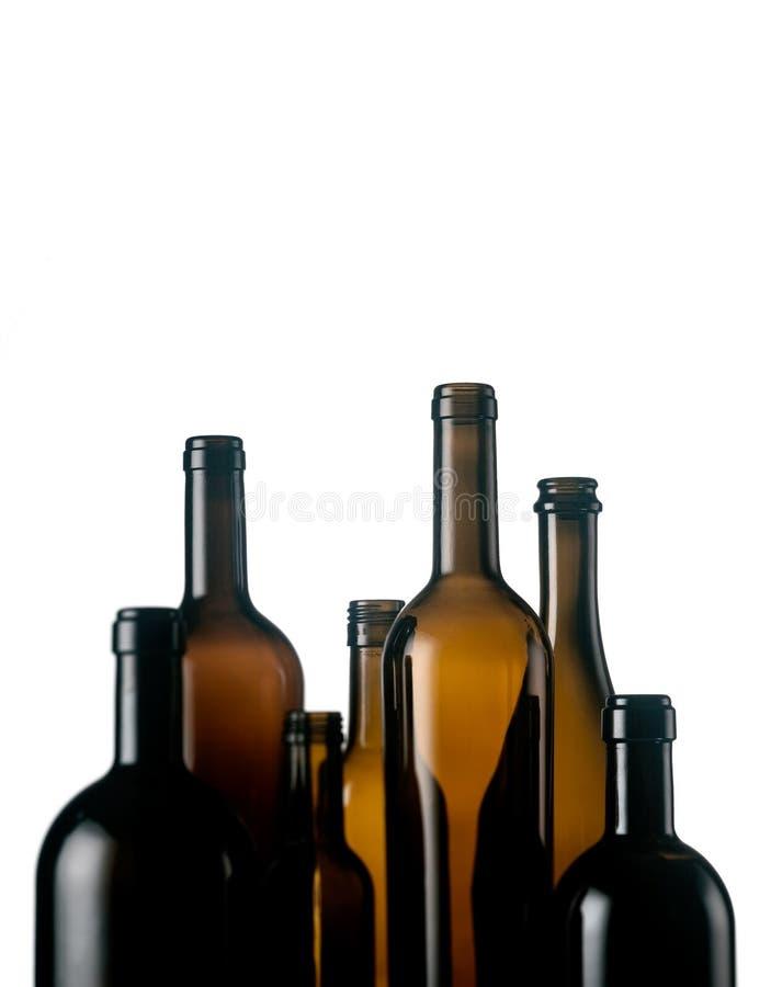 De lege Flessen van de Wijn stock afbeeldingen