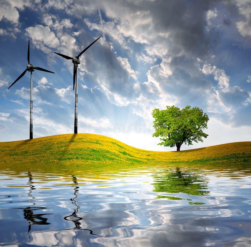 De lentelandschap met windturbine stock afbeelding