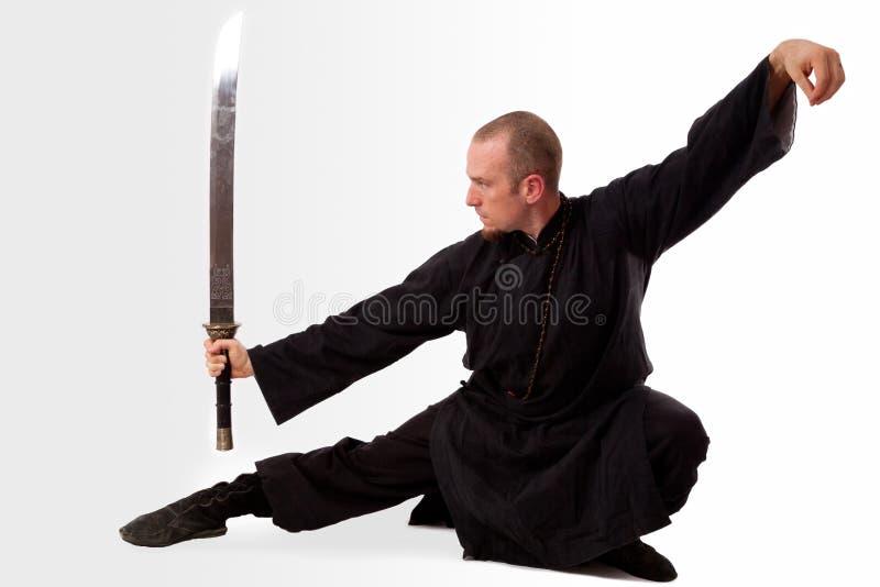 De leraar van vechtsporten met zwaard royalty-vrije stock afbeelding