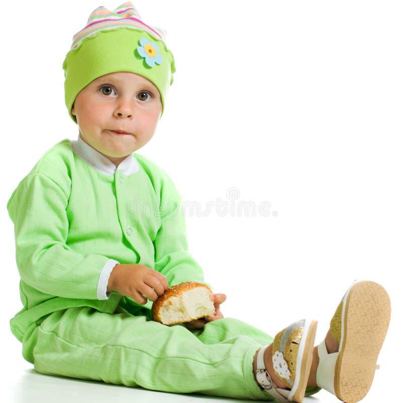 De leuke baby eet het brood royalty-vrije stock afbeelding