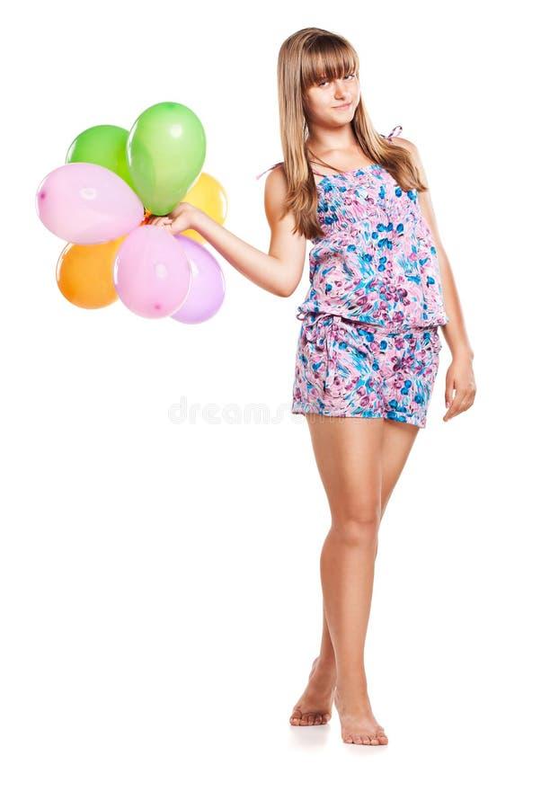 De leuke ballons van de tienerholding op wit stock foto