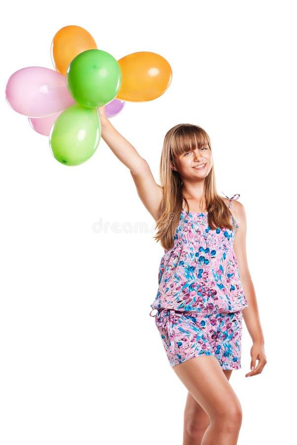 De leuke ballons van de tienerholding op wit royalty-vrije stock foto's
