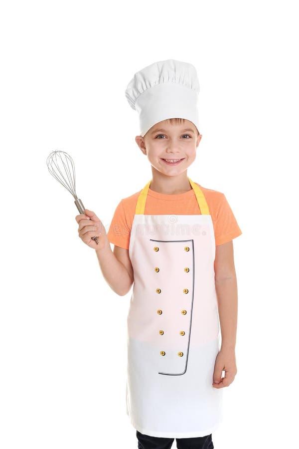 De leuke jongen in chef-kok eenvormig met zwaait, geïsoleerd royalty-vrije stock afbeeldingen