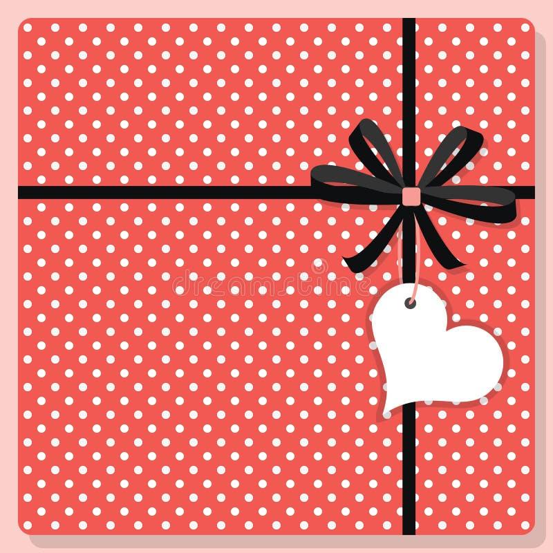 De leuke roze en witte gift van het stippenpatroon met boog en de hangende markering van de hartvorm stock illustratie