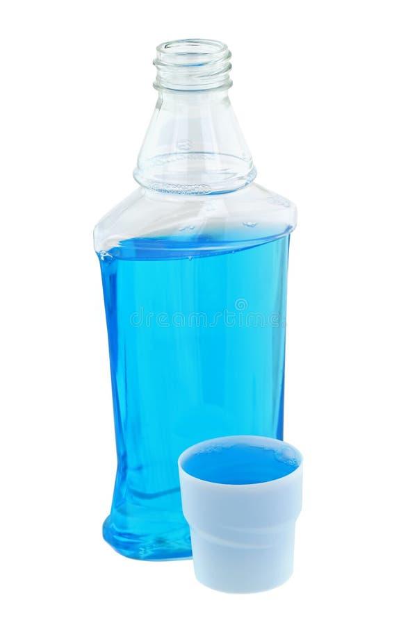 De lichtblauwe postvloeistof van de borstel antiseptische mondspoeling stock afbeeldingen