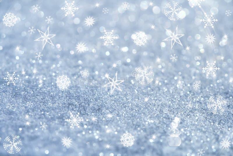 De lichtblauwe sneeuwvlokken en schitteren fonkelingen stock foto