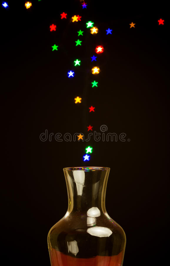 De lichten die van de stervorm bokeh uit vaas drijven stock foto