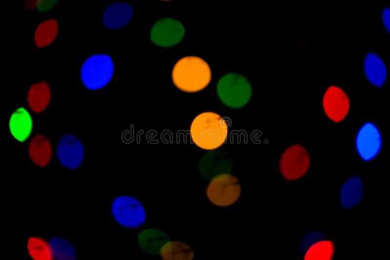 De lichten van Bokeh Mooie Kerstmisachtergrond en Nieuwjaar lichte Feestelijke samenvatting met royalty-vrije stock foto's