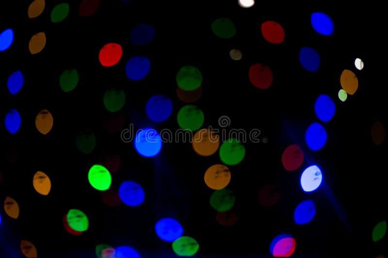 De lichten van Bokeh Mooie Kerstmisachtergrond en Nieuwjaar lichte Feestelijke samenvatting met stock afbeeldingen