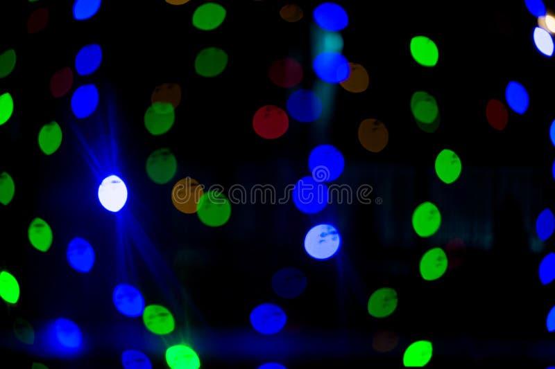 De lichten van Bokeh Mooie Kerstmisachtergrond en Nieuwjaar lichte Feestelijke samenvatting met royalty-vrije stock fotografie