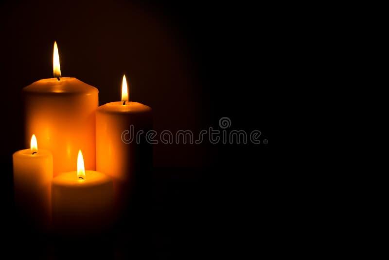 De lichten van kaarsen
