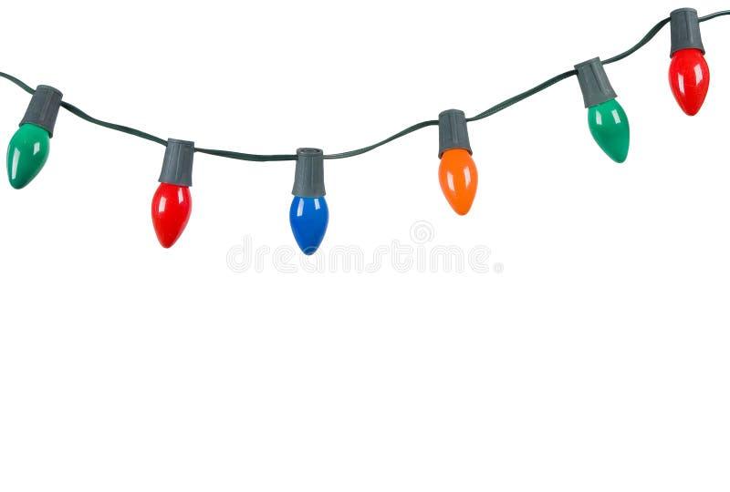De lichten van Kerstmis die op wit worden geïsoleerdm stock afbeeldingen