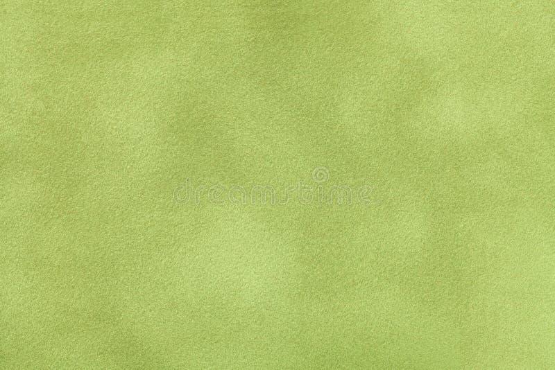De lichtgroene matte close-up van de suèdestof Fluweeltextuur royalty-vrije stock foto's