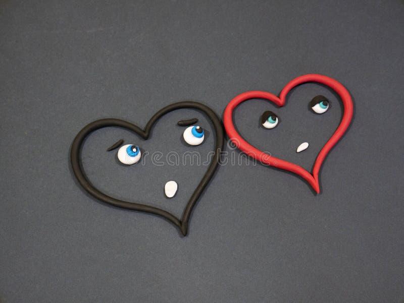 De liefde houdt niet van Scheuren van geluk Plasticinehart stock afbeelding