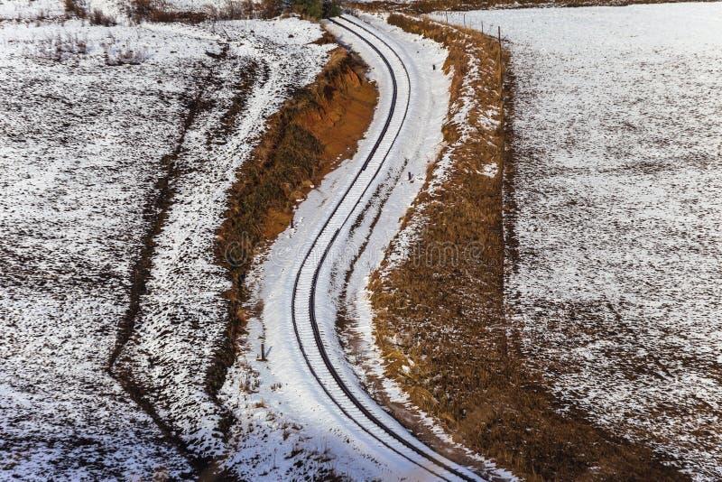 De Lijn van de trein buigt Sneeuw stock fotografie