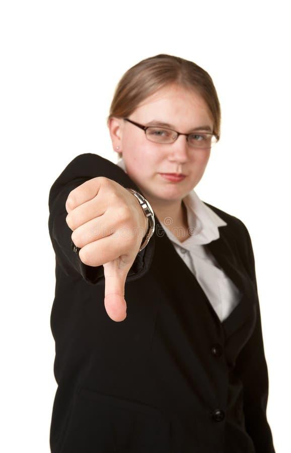 De los pulgares mujer de negocios joven abajo foto de archivo