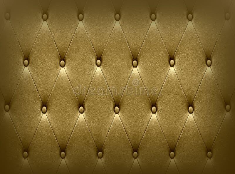 De luxueuze donkere gouden stoffering van de leerzetel royalty-vrije stock fotografie