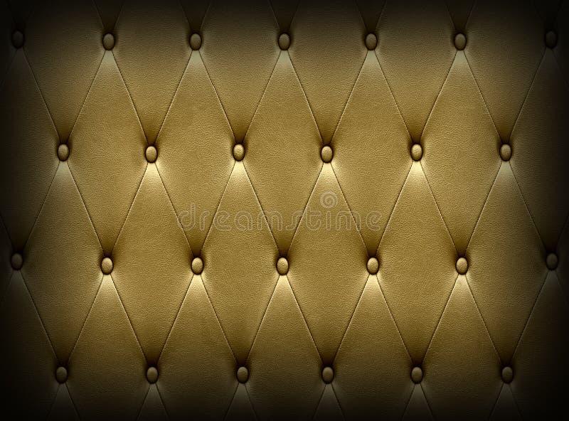 De luxueuze donkere gouden stoffering van de leerzetel stock foto