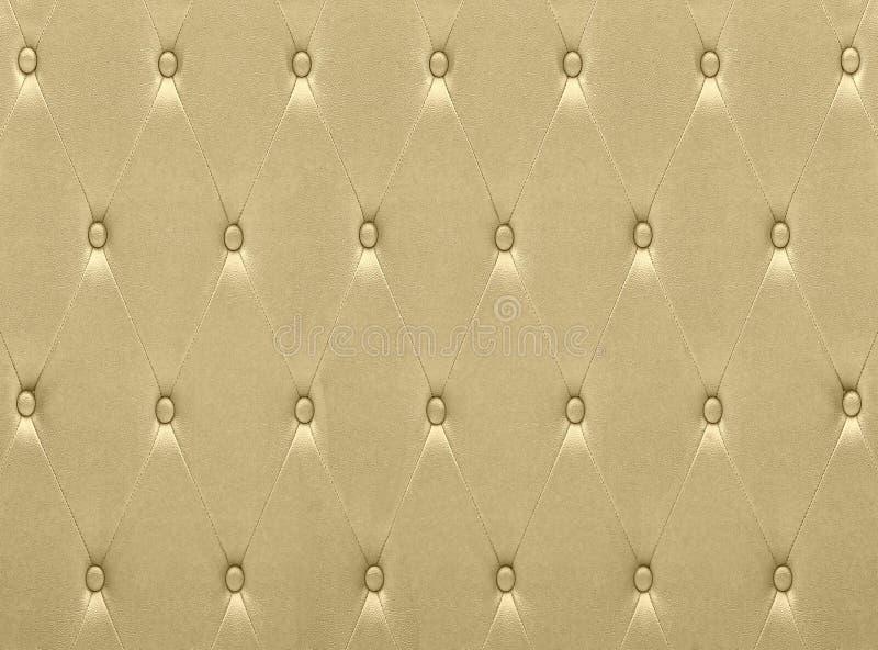 De luxueuze gouden stoffering van de leerzetel stock afbeelding